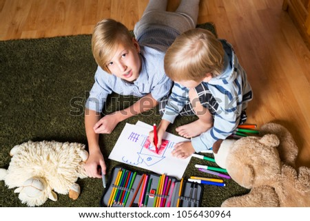 Two Brothers Lying On The Floor And Draw Images And Stock