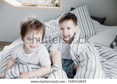 Two Little Toddler Boys Having Fun And Fighting Together In Bed Before Sleeping Indoors Brothers Play 768416869