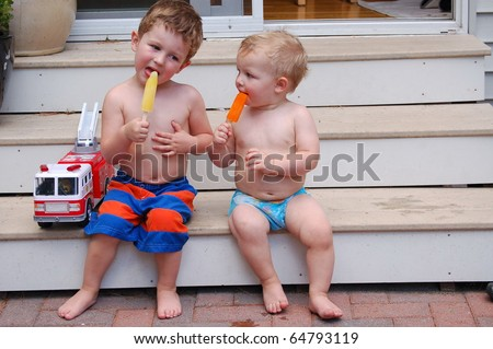 Brothers sit on step and enjoy summer treat/Enjoy the Moment/Take time to enjoy each day