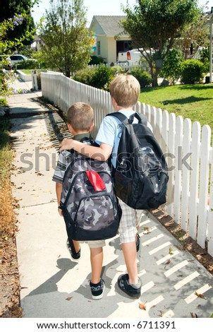 Brothers walk home from their first day at school