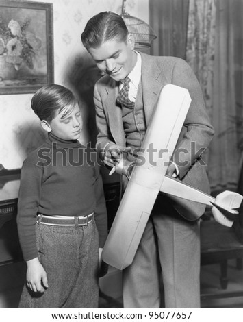 Brothers with model airplane
