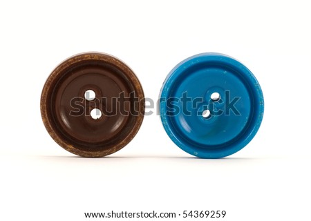 brown and blue clothes buttons ,isolated on white background
