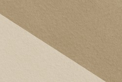 Brown and cream pastel colors felt fabric textured background with copy space for design and decoration.  Background image of two tone color wall.
