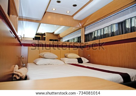 Brown and gold bedroom on yacht