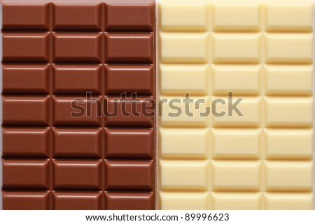 Brown and white chocolate in a row