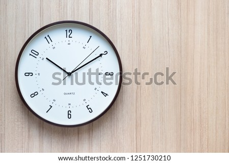 brown and white clock on wooden wall in late morning, free copy space