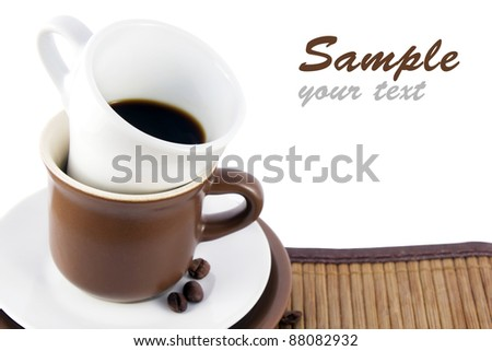 brown and white coffee cups with coffee beans