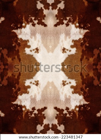 Brown and white kaleidoscope cow hide pattern