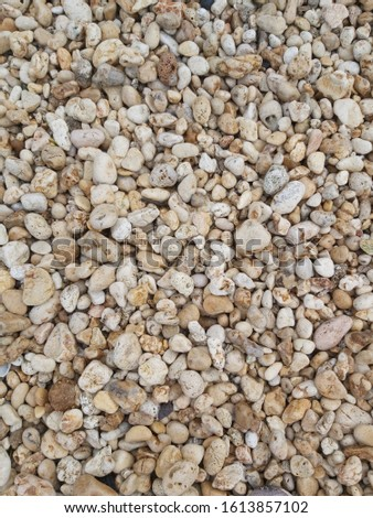 brown and white pebbles, beach pebbles, background