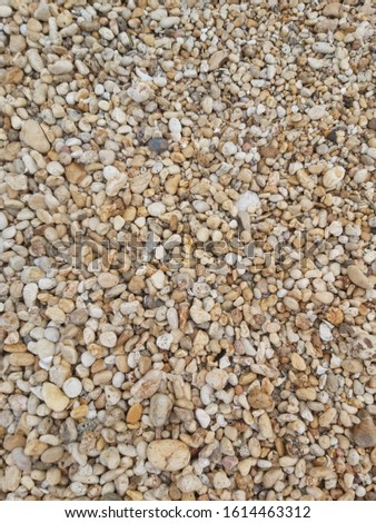 Brown and white pebbles, beach pebbles material background
