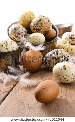 Brown and white speckled eggs on wooden table