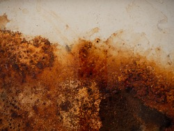 Brown and yellow wet rust and dirt on white enamel with smudges of water and drops. Rusted brown and white abstract texture. Corroded white metal background. Rusty white painted metal wall.