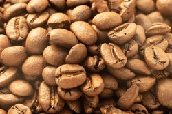 brown aromatic roasted coffee beans background