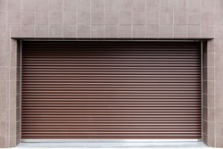Brown automatic roller shutter doors on the ground floor of the house