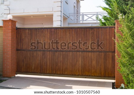 brown automatic wooden gates of ...