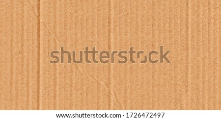 Brown background of paper texture or cardboard surface from a paper box There are wrinkles from the impact.Surface of the parcel box is wrinkled with Transport. nature packaging concept.