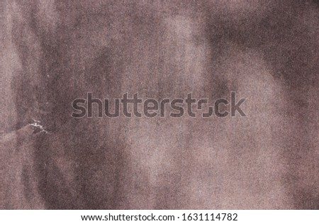 Brown background with stains. Brown paper texture. Empty template with space for text or image.