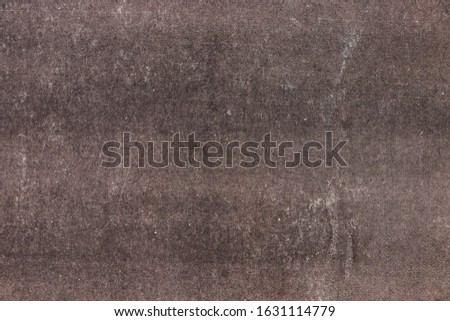 Brown background with stains. Brown paper texture. Vintage background and empty template with space for text or image.