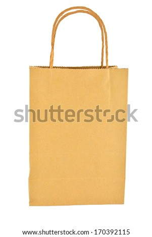 Brown bag against a white background with soft shadows. Copy space.