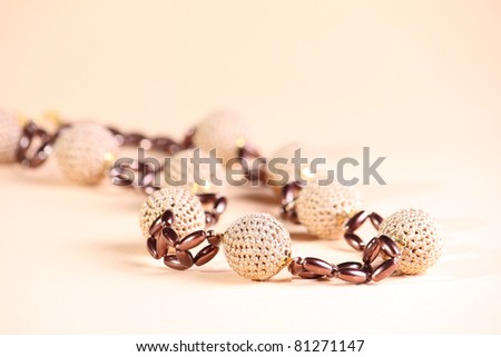 Brown beads at pink background