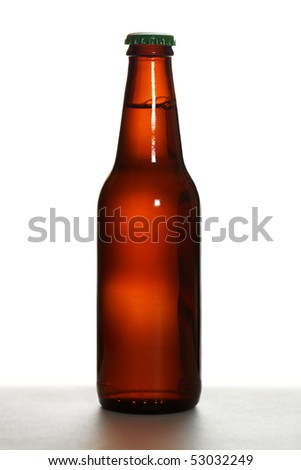 Brown beer bottle with green cap on white background