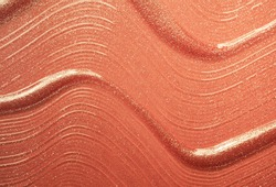 Brown beige lip gloss with shimmer textured background