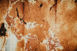 Brown, black and yellow rust and dirt on white enamel. Rusted brown and white abstract texture. Corroded white metal background. Rusty metal surface with streaks of rust. Rusty corrosion.Rusted metal