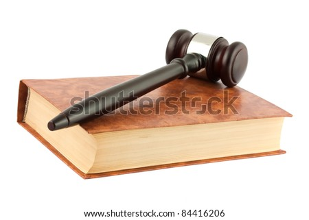 Brown book and gavel isolated on white background