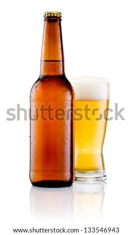 Brown bottle with drops and Glass of beer isolated on a white background