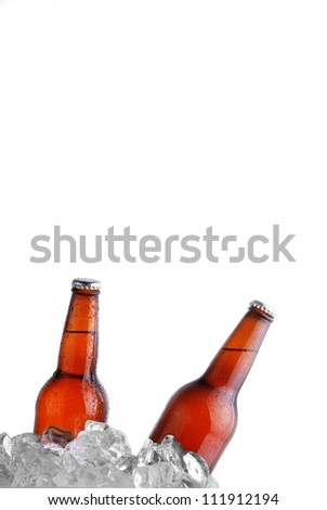 brown bottles of beer chilling on ice