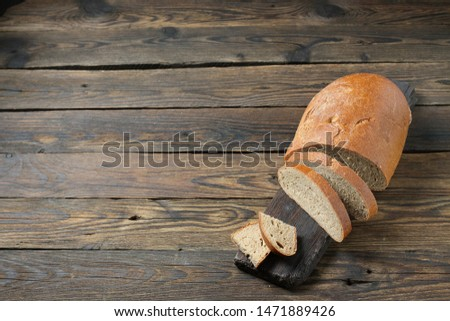 brown bread on a wooden table in a rustic style #1471889426