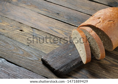 brown bread on a wooden table in a rustic style #1471889429