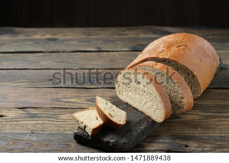 brown bread on a wooden table in a rustic style #1471889438