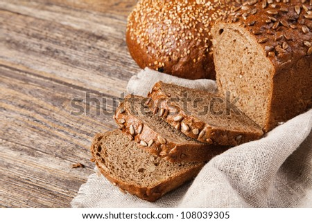 Brown bread on an old wooden table