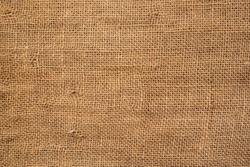 Brown burlap cloth background or sack cloth for packing