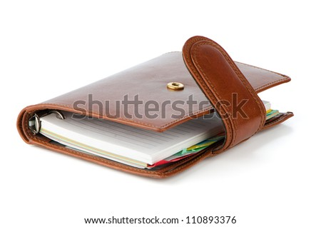 Brown business book isolated on white background.