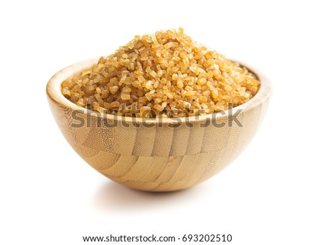 Brown cane sugar isolated on white background. Sweet sugar in bowl.  #693202510