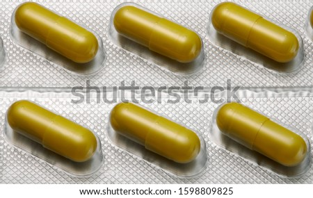 Brown capsules pill in blister pack arranged with beautiful pattern. Global healthcare concept. Antibiotics drug resistance. Antimicrobial capsule pills. Pharmaceutical industry. Pharmacy.