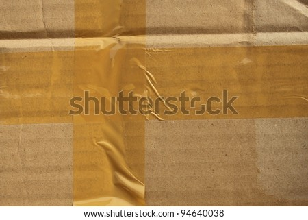 Brown cardboard box sealed with adhesive tape.