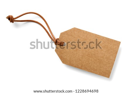 brown cardboard label with slim genuine leather cord,isolated #1228694698