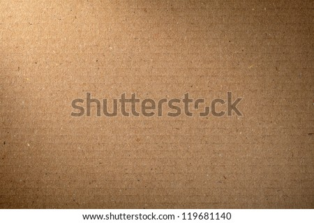 Brown cardboard texture for background, lighting from the left corner