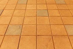 Brown cement tiles floor outside the building pattern and seamless background