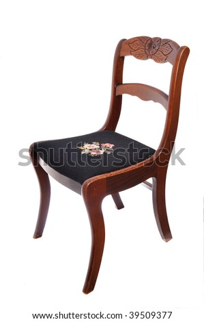 Brown chair isolated on white with flower design on seat