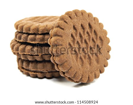 brown chocolate sandwich biscuits with cream filling on a white background