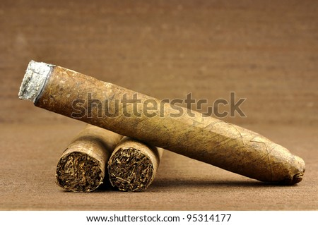 brown cigar burned