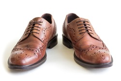 brown classic men's shoes on a white background