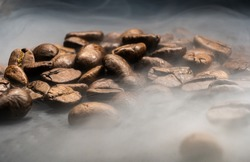 brown coffebeans covered in steam