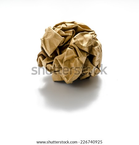 brown coloe crumpled paper ball on a white background