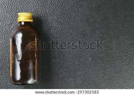 Brown color bottle with gold color metal lid represent the medicine containing bottle concept related idea.