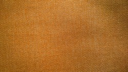 Brown color fabric background. Natural material, linen or cotton. Nature shade template. Concept of environment. Textiles and apparel industry development. Texture template. Copy space. Backdrop.